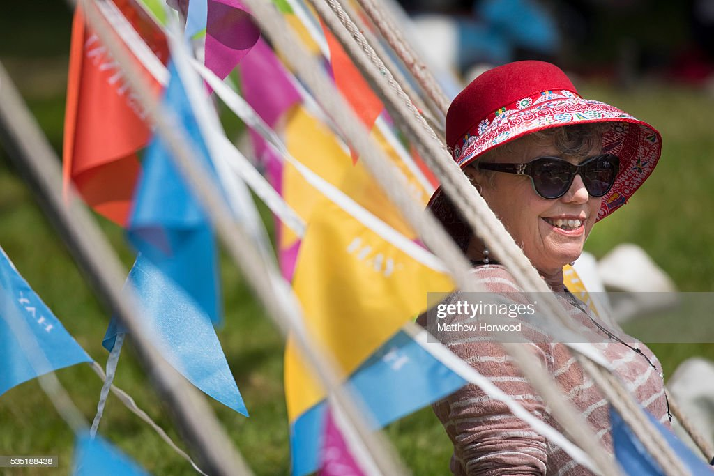 A woman enjoys the warm summer weather during the 2016 Hay Festival on May 29, 2016 in Hay-on-Wye, Wales. The Hay Festival is an annual festival of literature and arts now in its 29th year.