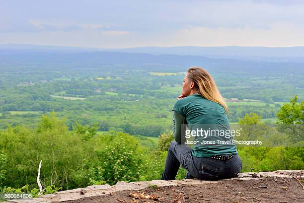 Woman enjoys view over South Downs