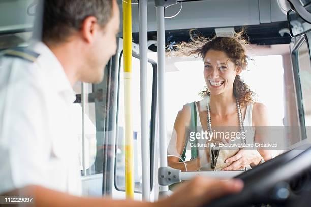 Woman entering a bus