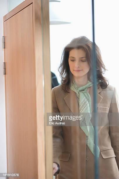 Woman entering a house