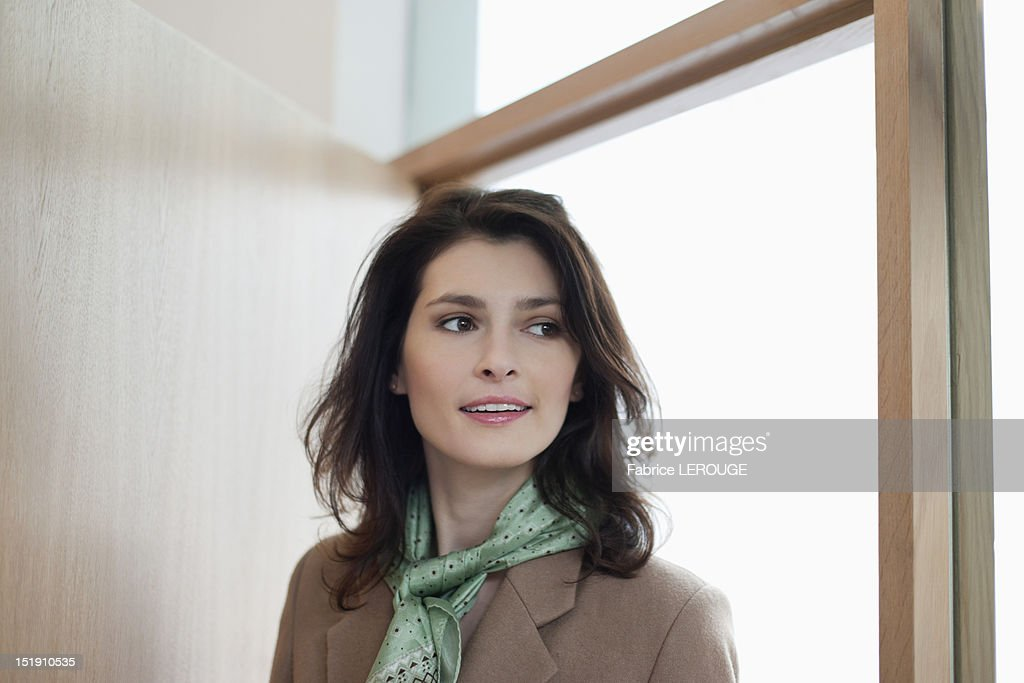 Woman entering a room to discover surprise