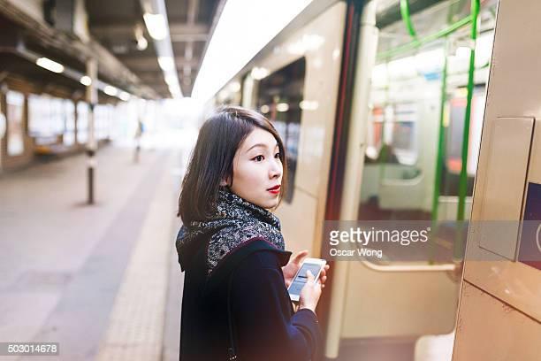 Woman entering a subway train