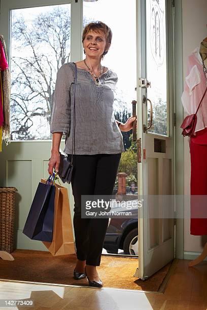 Woman entering Boutique shop