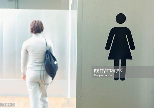 Woman entering gym locker room
