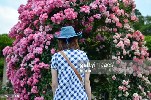 Woman entering the room of roses