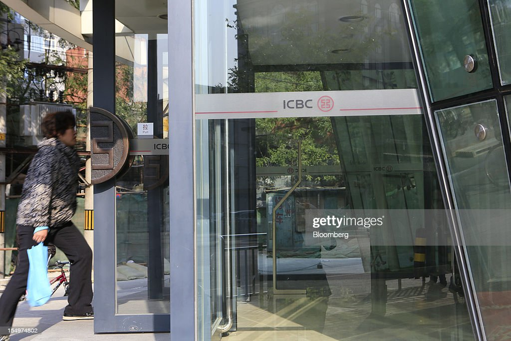 A woman enters a branch of the Industrial and Commercial Bank of China Ltd. (ICBC) in Beijing, China, on Monday, Oct. 29, 2012. ICBC is expected to announce third-quarter results on Oct. 30. Photographer: Nelson Ching/Bloomberg via Getty Images