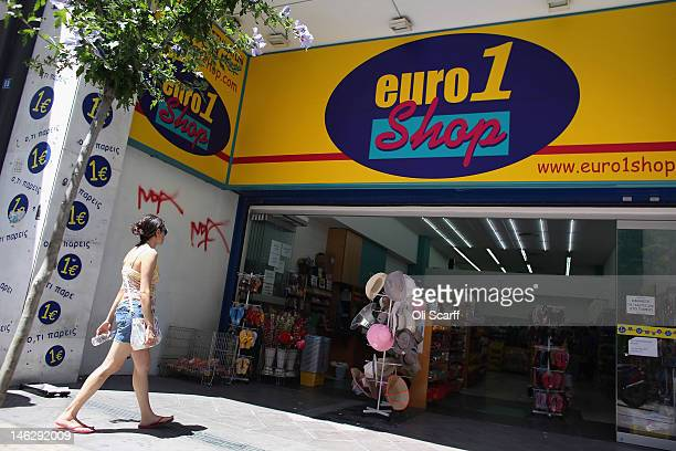 A woman enters a discount '1 Euro' shop on June 13 2012 in Athens Greece The Greek electorate are due to go to the polls in a rerun of the general...