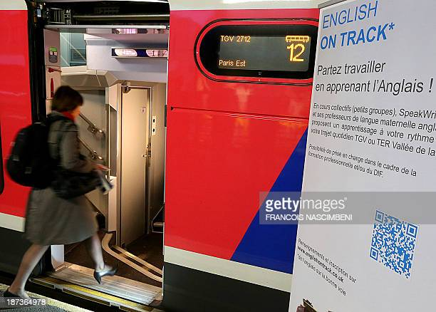 JULIEN A woman enters a high speed TGV train departing for Paris on November 7 2013 at Reims train station in which travellers can have English...