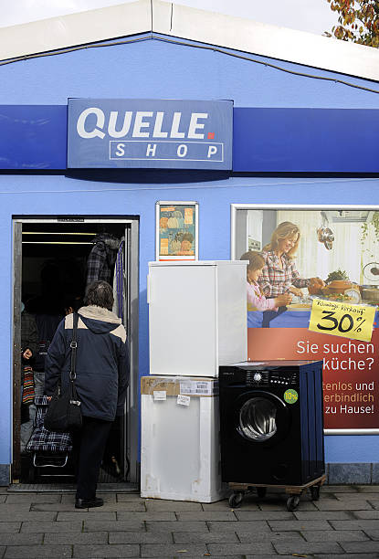 A Woman Enters A Quelle Store In Essen Pictures Getty Images