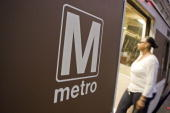 A woman enters a Red Line Metro train car at the Union Station stop in Washington DC US on Monday Aug 24 2009 Washington's Metro run by the...