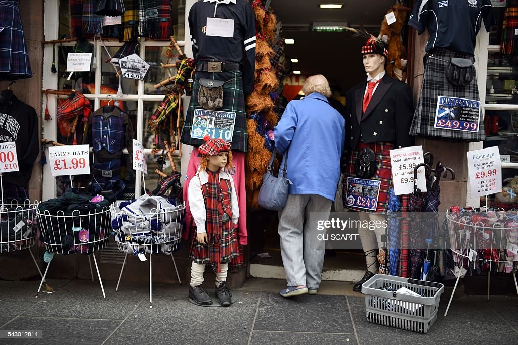 A woman enters a shop selling tartan garments in Edinburgh, Scotland on June 25, 2016. Scotland wants immediate talks with the European Union on protecting its place in the bloc, after Britain's vote to leave the EU, First Minister Nicola Sturgeon said Saturday. Speaking after an emergency meeting of her cabinet, Sturgeon said it had agreed to seek 'immediate discussions with the EU institutions and other EU member states to explore all possible options to protect Scotland's place in the EU.' SCARFF