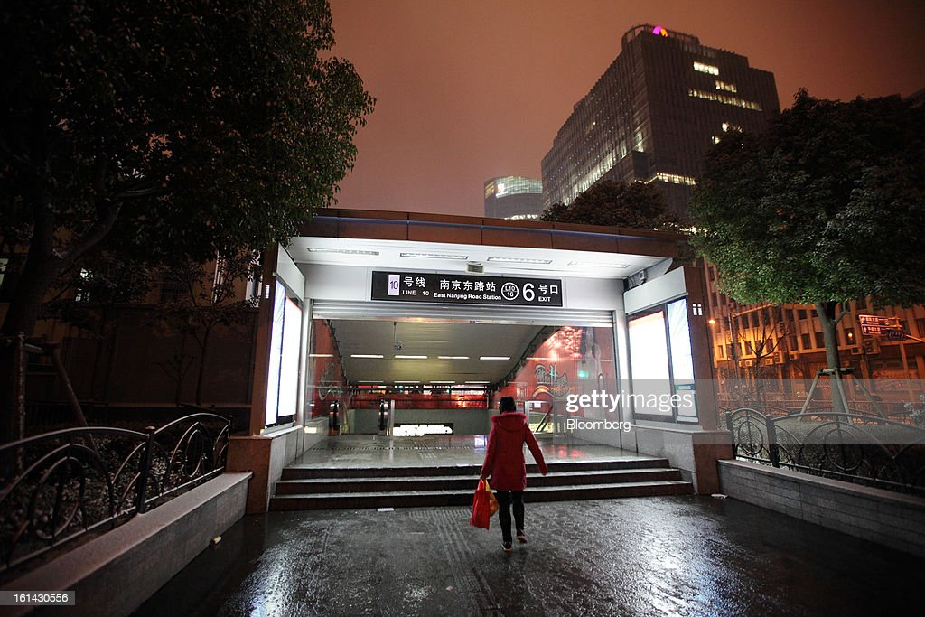 A woman enters a subway station in Shanghai, China, on Friday, Feb. 8, 2013. A record 3.41 billion passenger trips may be made this year during the Lunar New Year period, according to the National Development and Reform Commission. Photographer: Tomohiro Ohsumi/Bloomberg via Getty Images