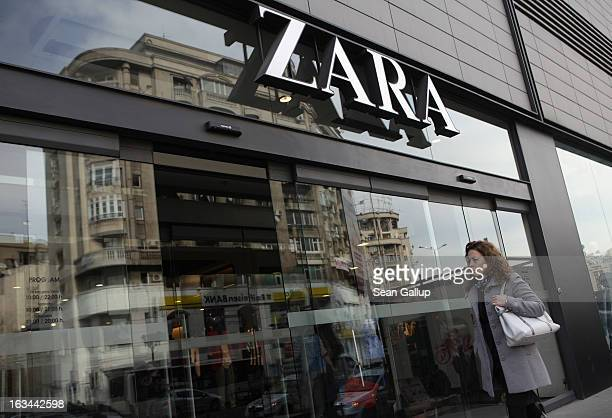 A woman enters a Zara clothing store on March 8 2013 in Bucharest Romania Both Romania and Bulgaria have been members of the European Union since...