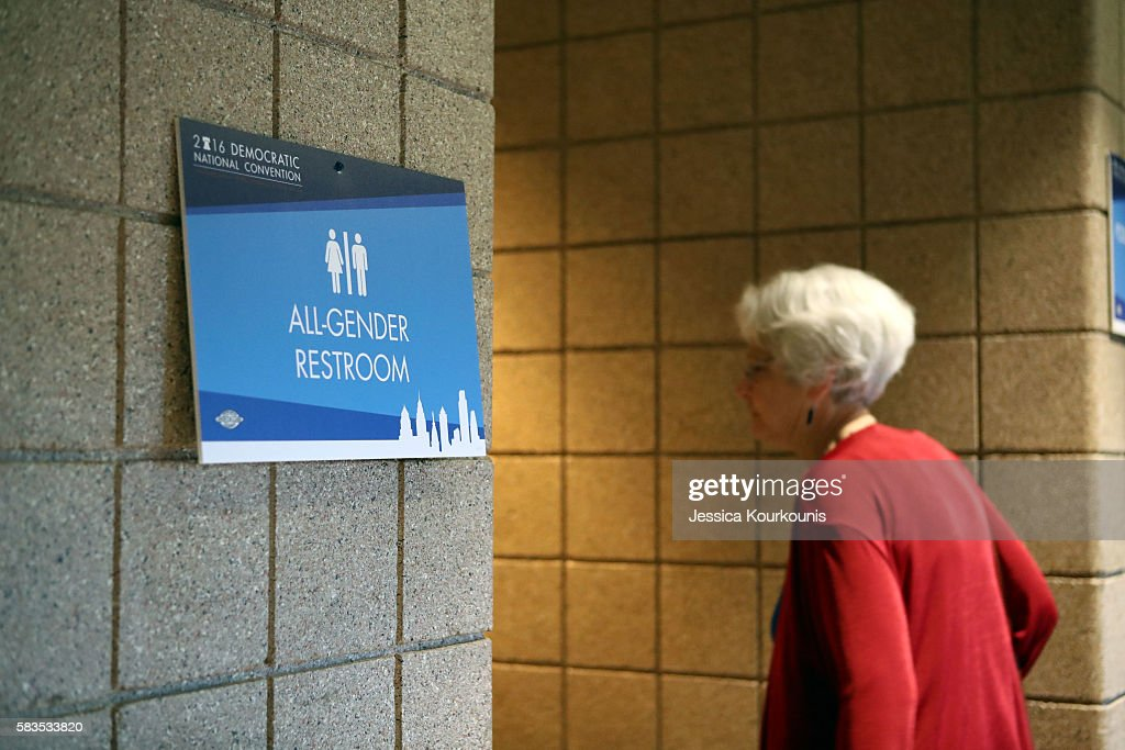 A woman enters all gender public restroom at Wells Fargo Center before day two of the Democratic National Convention on July 26 2016 in Philadelphia...