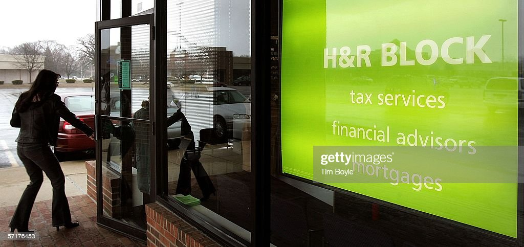 A woman enters an H&R Block facility March 24, 2006 in Mount Prospect, Illinois. Americans are preparing for the income tax filing deadline next month whether using tax software, filing on the paper forms or using a tax preparer.