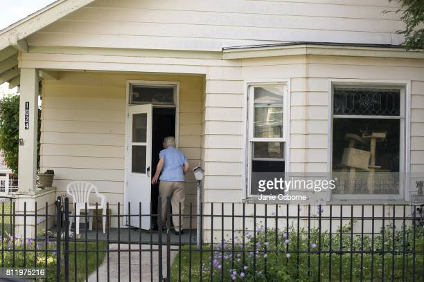 A woman enters her home near downtown Butte on July 6 2017 in Butte Montana Butte is home to the toxic Berkeley Pit Formerly an open pit copper mine...