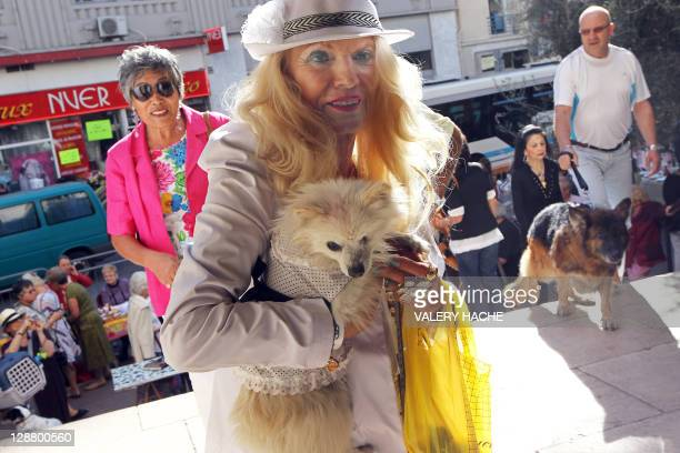 A woman enters in the SaintPierred'Arene's church with her dogs to attend a mass dedicated to animals on October 9 2011 in the southeastern French...