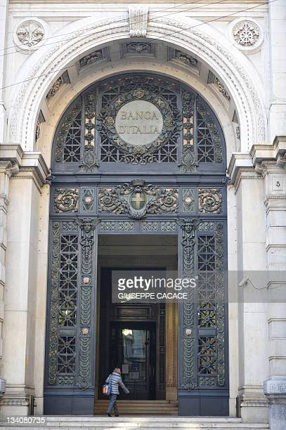 A woman enters the Bank of Italy in Milan on November 25 2011 The Bank of Italy was forced to pay recordhigh rates the same day in a 10billioneuro...