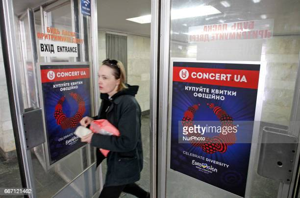 A woman enters the doors of the subway station with baners of the logo of the Eurovision Song Contest 2017 in center Kiev Ukraine 10 April 2017 The...