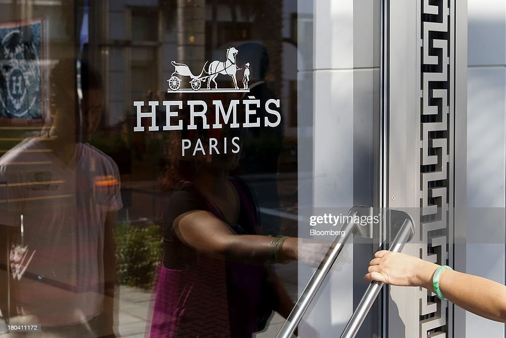 A woman enters the Hermes International store on Rodeo Drive in Beverly Hills, California, U.S., on Wednesday, Sept. 11, 2013. The U.S. Census Bureau is scheduled to release retail sales figures on Sept. 13. Photographer: Patrick T. Fallon/Bloomberg via Getty Images