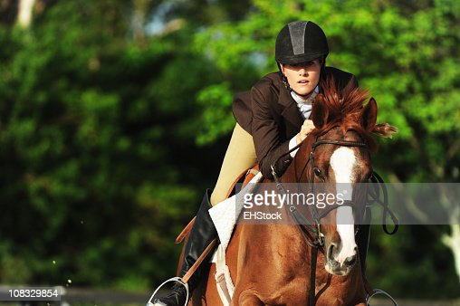 Woman Equestrian Riding Jumping on Show Horse