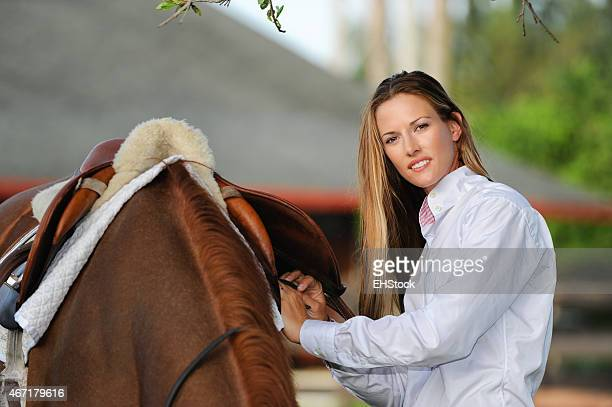 Woman Equestrian with Chestnut Mare Horse on Ranch
