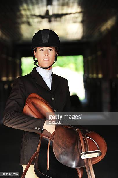 Woman Equestrian with English Horse Saddle in Barn