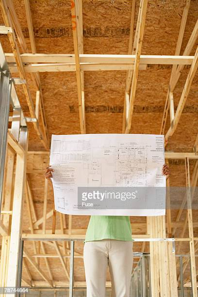 Woman Examining Building Plans