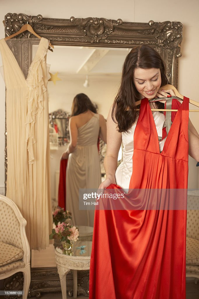 Woman examining dress in store