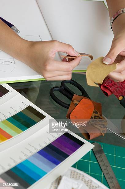 Woman examining fabric and color samples