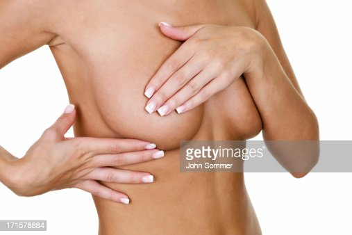 Woman examining her breast for cancer : Stock Photo