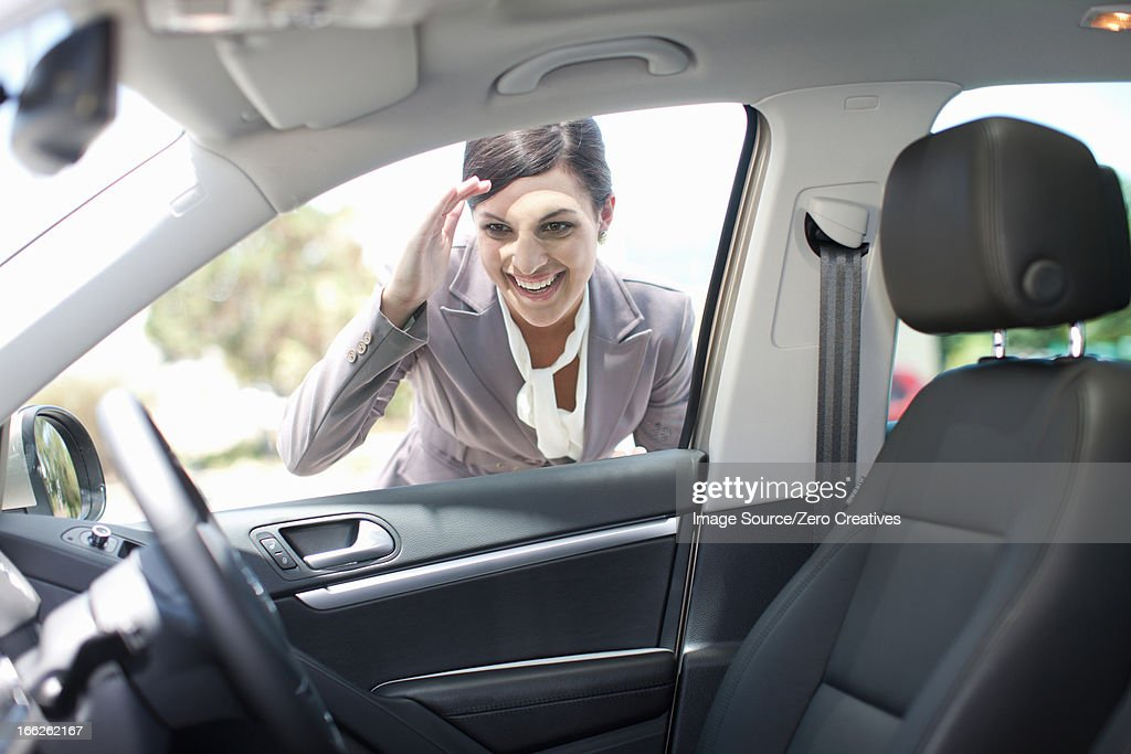 Woman examining new car : Stock Photo