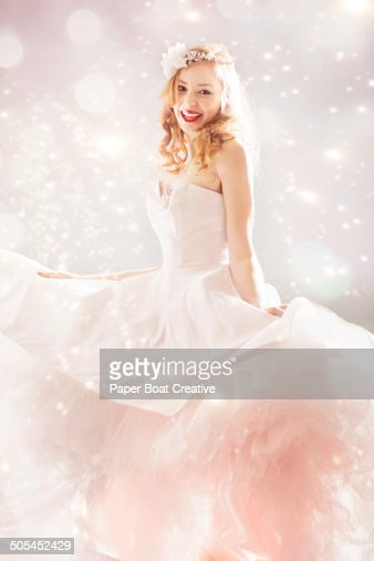 Woman excited to wear her new wedding dress