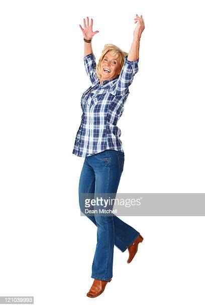 Woman Excitedly Jumping in the Air - Isolated