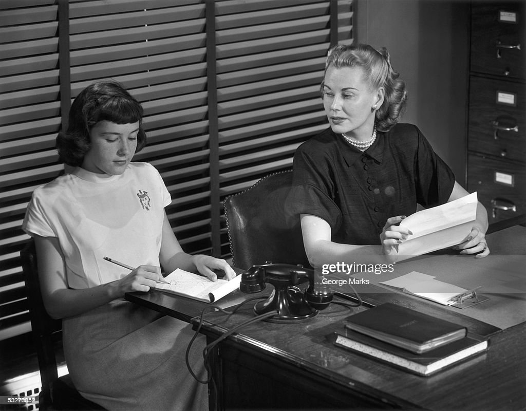 Woman executive dictating to secretary : Stock Photo