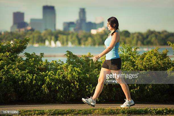 Woman Exercise Power Walking in Urban City Park, Minneapolis, Minnesota