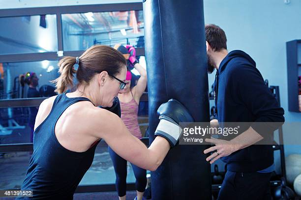 Woman Exercise Workout Boxing in Health Club Facility