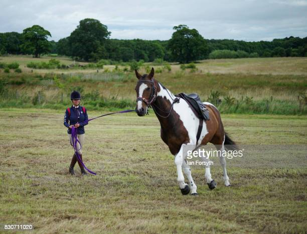 A woman exercises her horse before competing during the 194th Sedgefield Show on August 12 2017 in Sedgefield England The annual show is held on the...