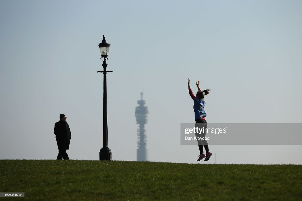 A woman exercises in the sunshine on Primrose Hill on March 4, 2013 in London, England. The Met office has predicted the warmest day of the year tomorrow with a top temperature of 15 degrees in some parts of the country.