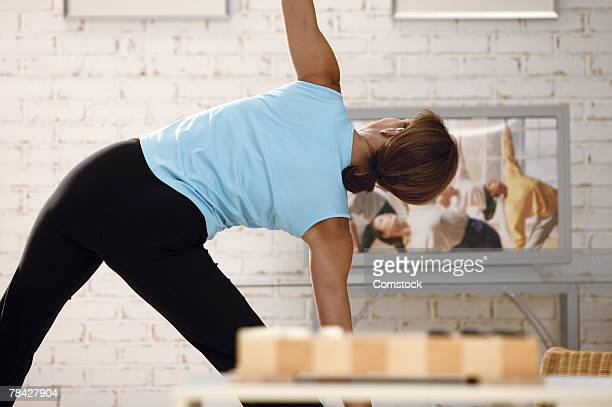 Woman exercising along with exercise video
