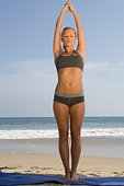 Woman exercising at beach