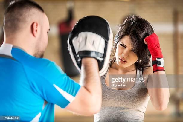 Woman exercising boxing.