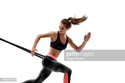 Frau Ausübung Widerstandsbänder Fitness Studio Silhouette isoliert auf weißem Hintergrund : Stock-Foto