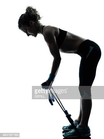 Mujer ejercicio fitness entrenamiento gymstick : Foto de stock