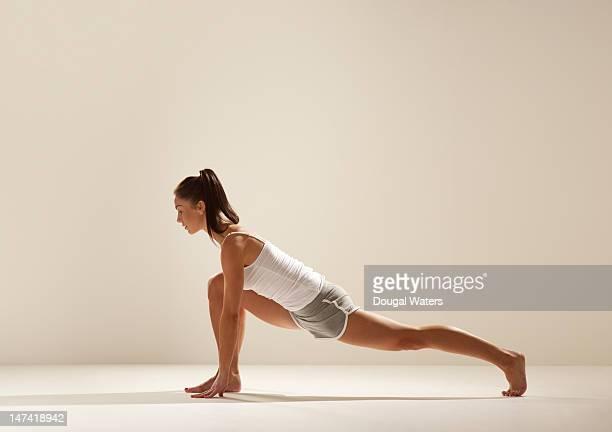 Woman exercising in studio.