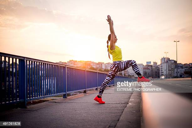 Woman exercising on the bridge