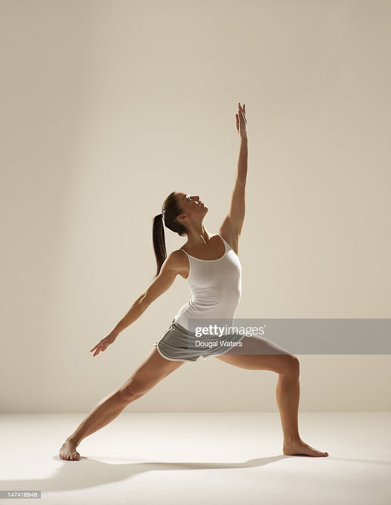 Woman exercising on white. : Stock Photo
