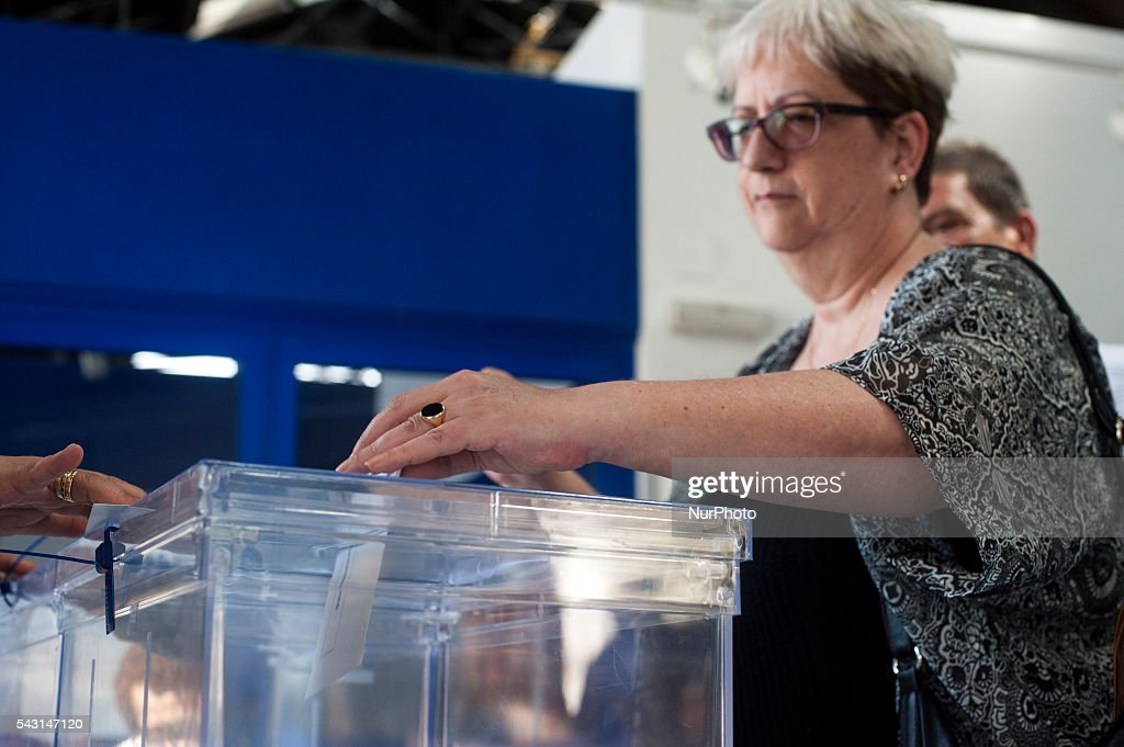A Woman exercising the right to vote in the general election on June 26 in Spain . Spanish voters head back to the polls after the last election in December failed to produce a government. Latest opinion polls suggest the Unidos Podemos left-wing alliance could make enough gains to come in second behind the ruling center right Popular Party.