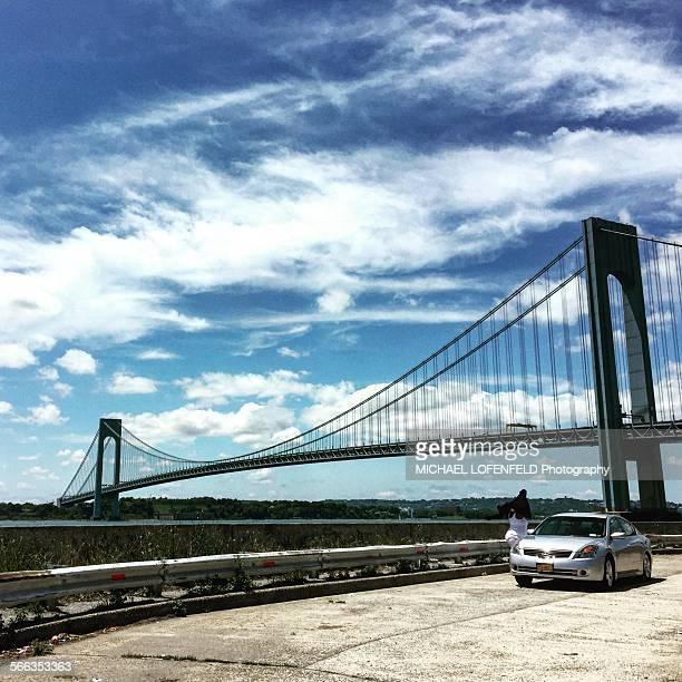 Woman exited the car to enjoy the Verrazano Bridge from Brooklyn NY