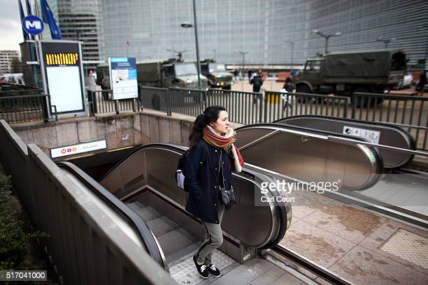 A woman exits a Metro station next to the European Commission headquarters following yesterday's attack on March 23 2016 in Brussels Belgium Belgium...